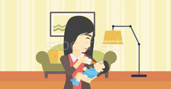 Mother feeding baby. Stock photo © RAStudio
