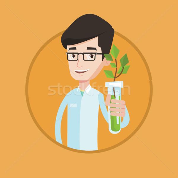 Stock fotó: Tudós · kémcső · tart · fiatal · növény · férfi