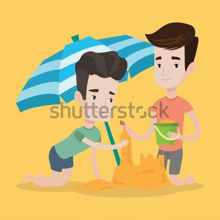 Férfi barátok épület homokvár tengerpart fiatal Stock fotó © RAStudio