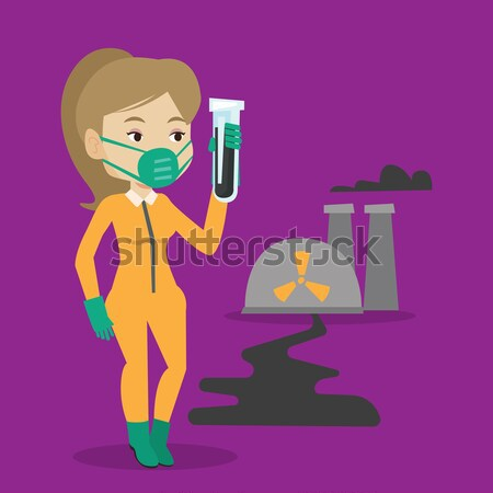 Woman in radiation protective suit with test tube. Stock photo © RAStudio