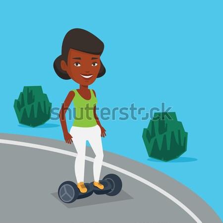Nő lovaglás elektromos moped park szabadtér Stock fotó © RAStudio