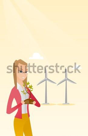 Woman holding small plant vector illustration. Stock photo © RAStudio