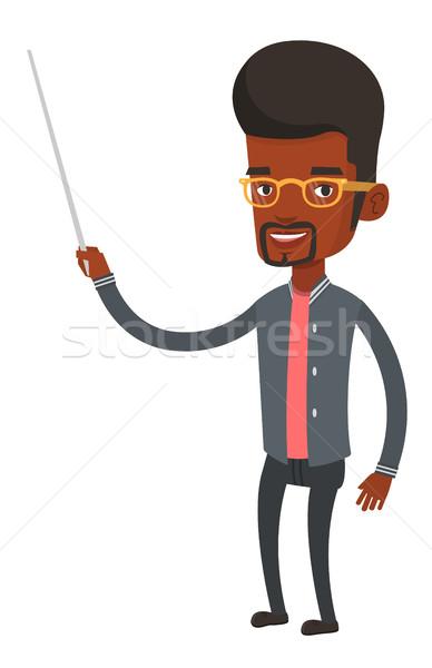 Teacher or student standing with pointer. Stock photo © RAStudio