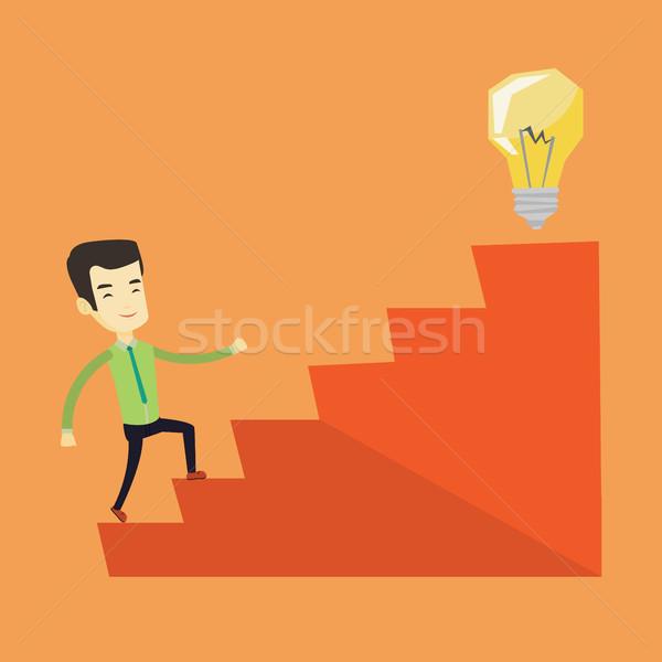 Business man walking upstairs to the idea bulb. Stock photo © RAStudio