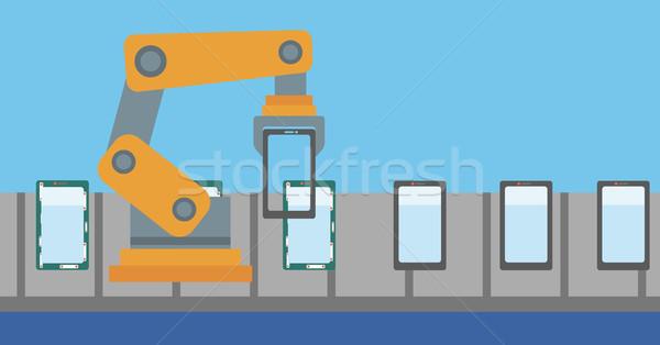 Robótico produção linha smartphones robô trabalhando Foto stock © RAStudio