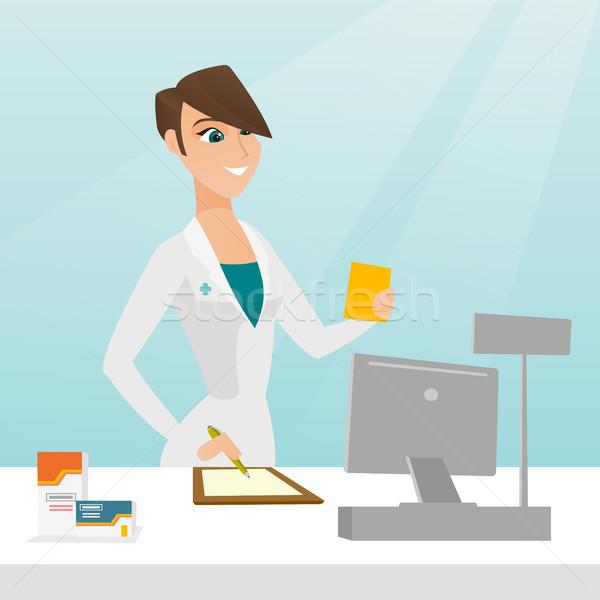 Pharmacien écrit ordonnance note Photo stock © RAStudio