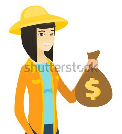 African-american traveler holding bag of money. Stock photo © RAStudio