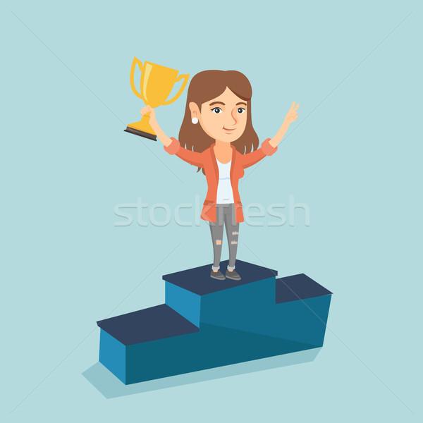 Woman standing on a pedestal with business award. Stock photo © RAStudio