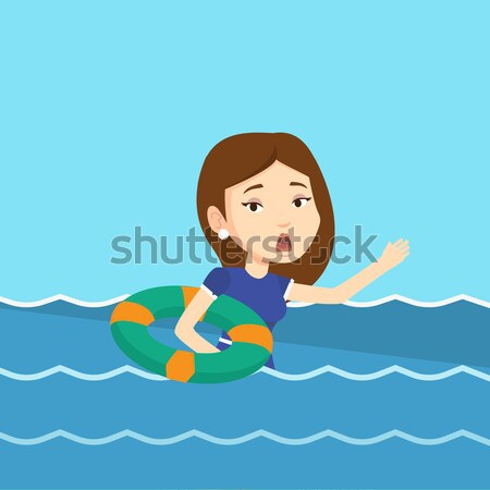 Young business woman sinking and asking for help. Stock photo © RAStudio