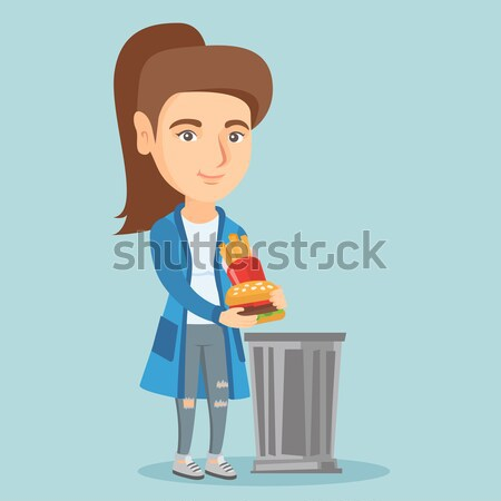 Woman throwing out junk food into the trash can. Stock photo © RAStudio