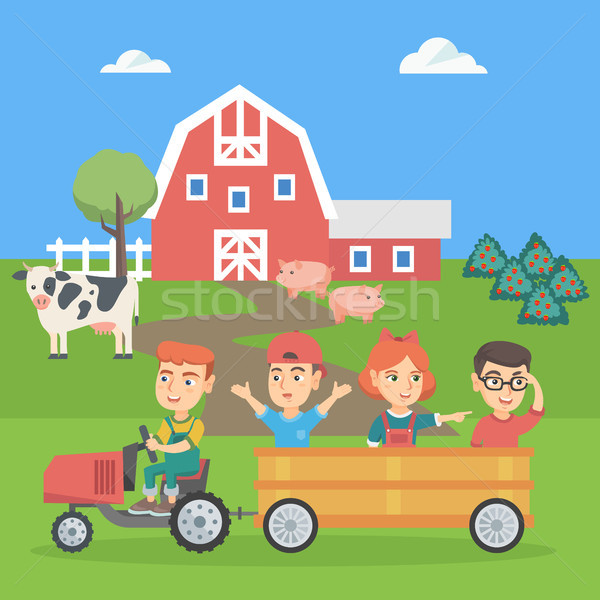 Boy driving a tractor with his friends in trailer. Stock photo © RAStudio