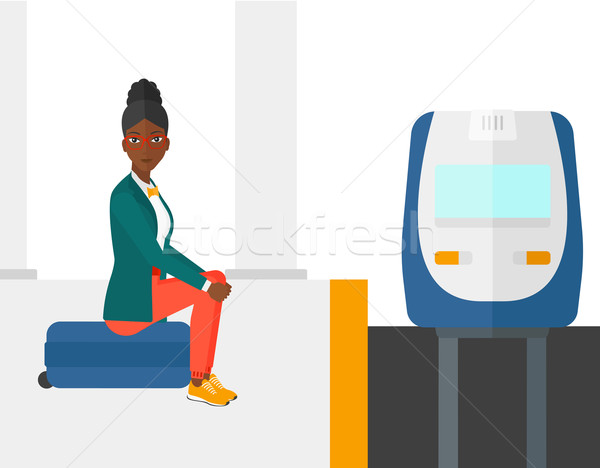 Woman sitting on railway platform. Stock photo © RAStudio