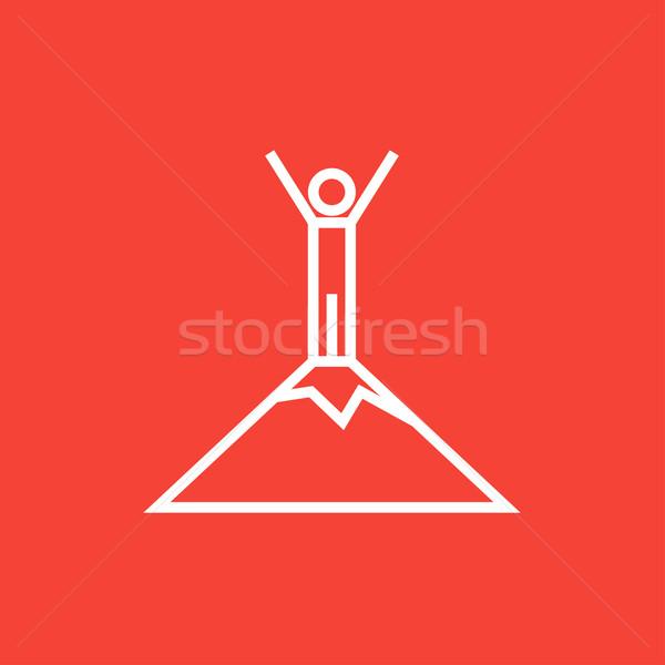 Man standing on top of mountain line icon. Stock photo © RAStudio