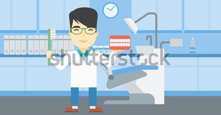 Orvos injekciós tű kórház ázsiai férfi orvos tart Stock fotó © RAStudio