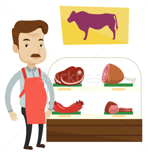 Butcher offering fresh meat in butchershop. Stock photo © RAStudio