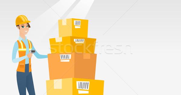 Entrepôt travailleur Barcode boîte scanner Photo stock © RAStudio