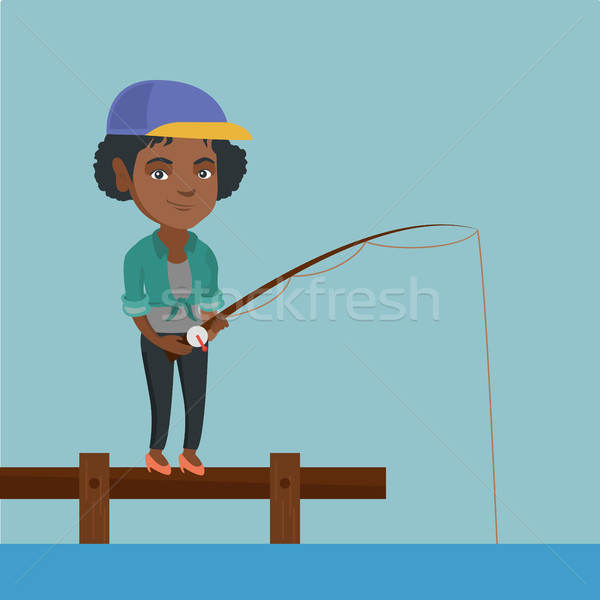 Young african-american woman fishing on jetty. Stock photo © RAStudio