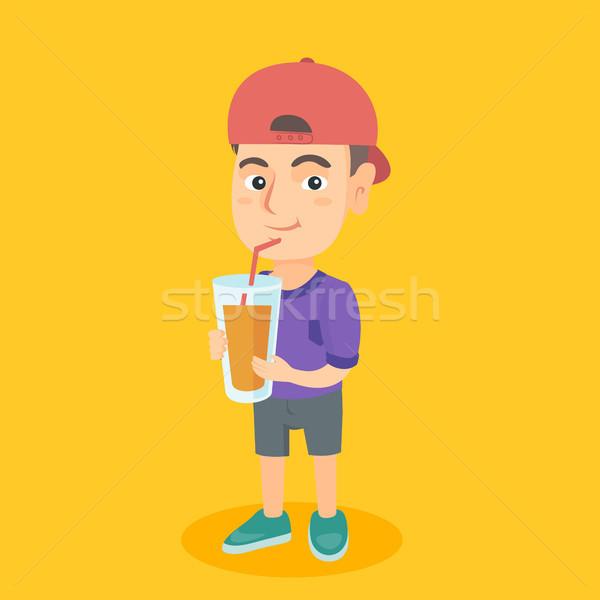 мальчика питьевой апельсиновый сок соломы кавказский Сток-фото © RAStudio