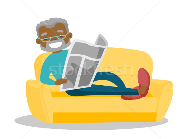 Man laying on the couch and reading a newspaper. Stock photo © RAStudio