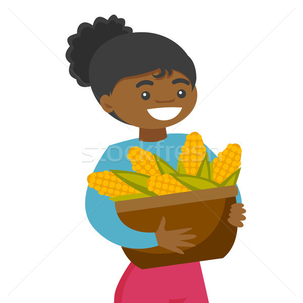 A black happy woman with a basket of corncobs. Stock photo © RAStudio