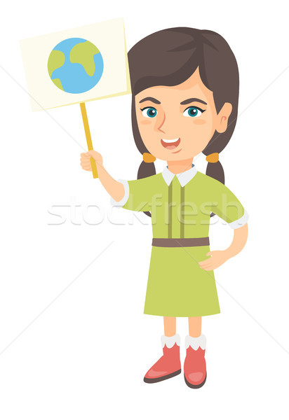 Caucasian girl holding a placard with planet. Stock photo © RAStudio