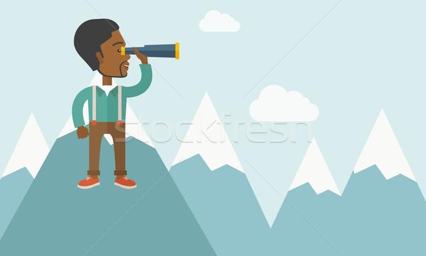 Stock photo: Black man on top of blue mountain.