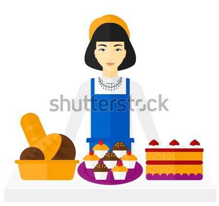 Sikeres kisvállalkozás tulajdonos áll asztal sütemény Stock fotó © RAStudio