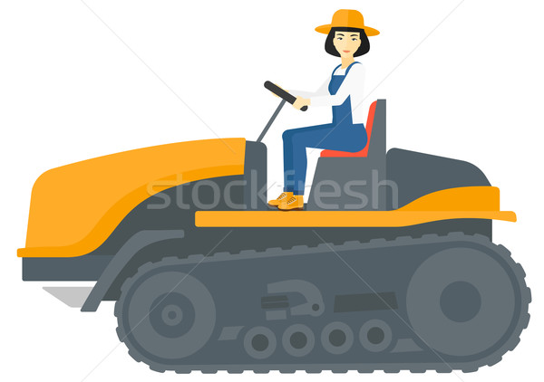 Farmer driving catepillar tractor. Stock photo © RAStudio