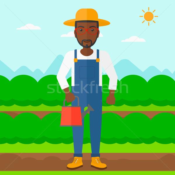 農家 じょうろ 男 フィールド ストックフォト © RAStudio