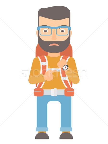 Angry backpacker pointing at wrist watch. Stock photo © RAStudio