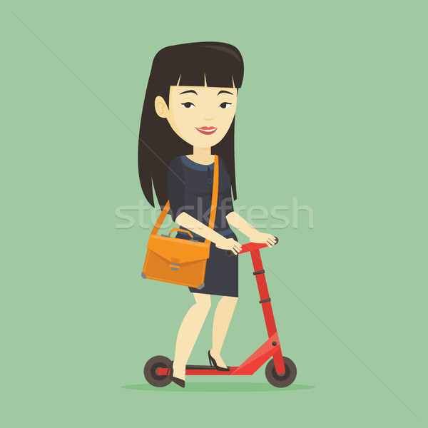 女性 ライディング キック スクーター アジア ビジネス女性 ストックフォト © RAStudio