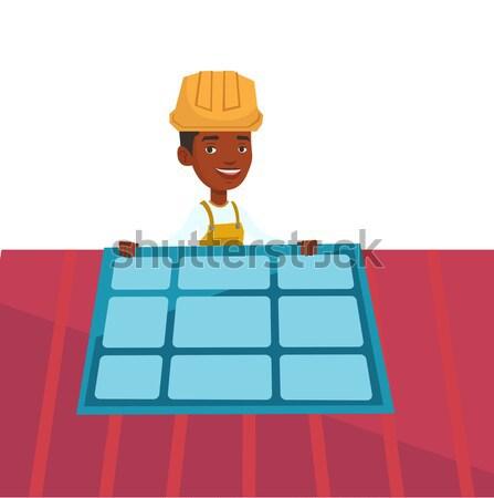 Stock photo: Constructor installing solar panel.