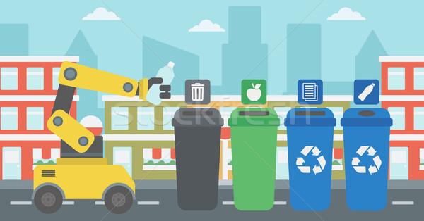 Robot throwing away plastic bottle. Stock photo © RAStudio