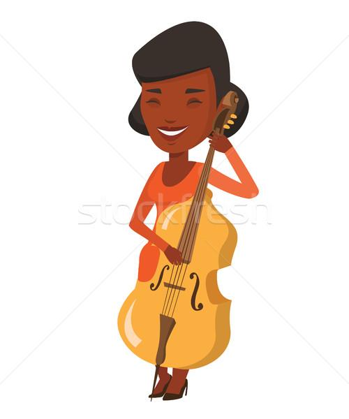 Kobieta gry wiolonczela młodych szczęśliwy muzyk Zdjęcia stock © RAStudio