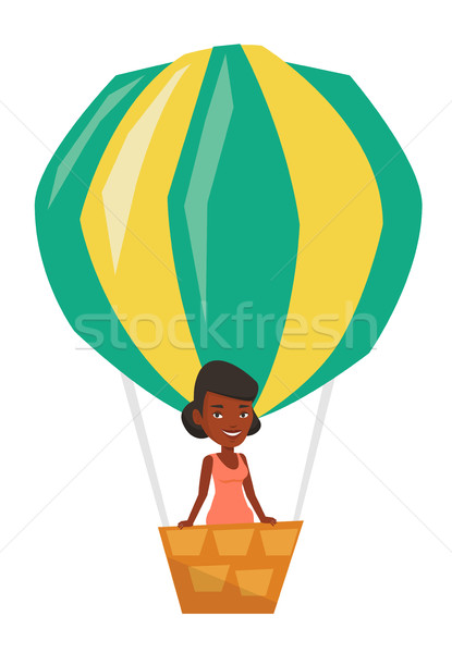 Woman flying in hot air balloon. Stock photo © RAStudio