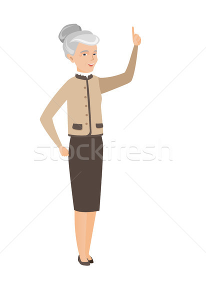 Caucasian business woman pointing forefinger up. Stock photo © RAStudio
