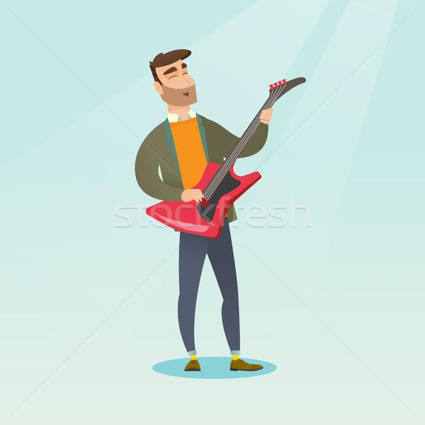 Man playing the electric guitar. Stock photo © RAStudio