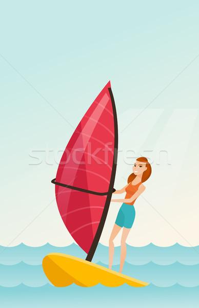 Jovem caucasiano mulher windsurf mar em pé Foto stock © RAStudio