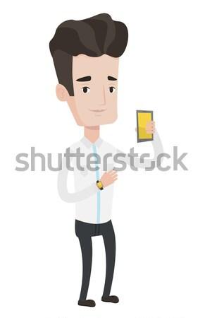 Man measuring heart rate pulse with smartphone. Stock photo © RAStudio