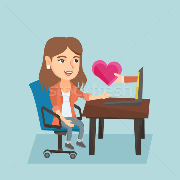 Woman looking for online date on the internet. Stock photo © RAStudio
