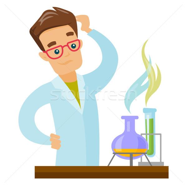Caucasian student working in laboratory class. Stock photo © RAStudio
