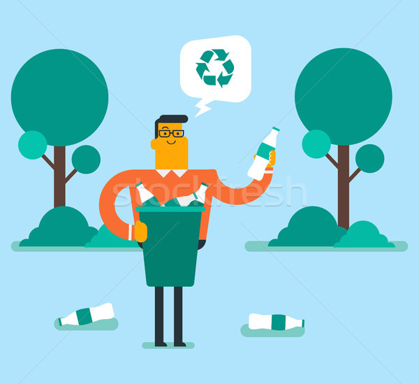 Stock photo: Man picking up plastic bottle in a recycling bin.
