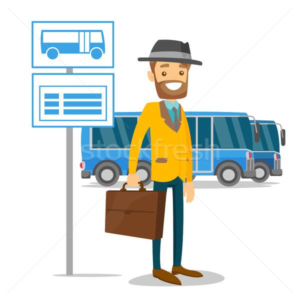 Homem espera parada de ônibus horário homem branco caucasiano Foto stock © RAStudio