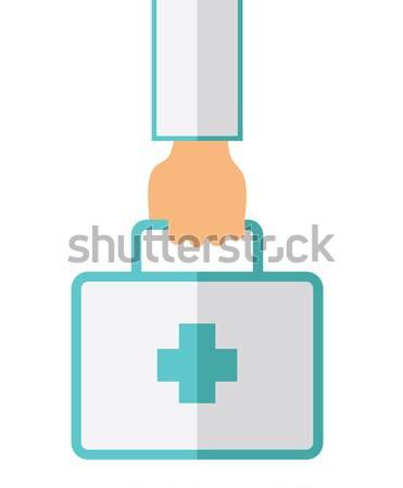 Hand Holding First Aid Box Stock photo © RAStudio