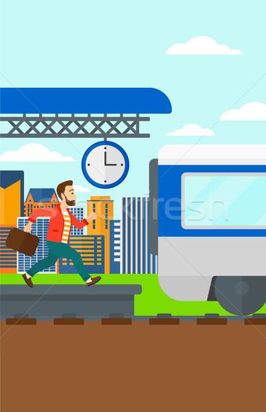 Man running along the platform. Stock photo © RAStudio