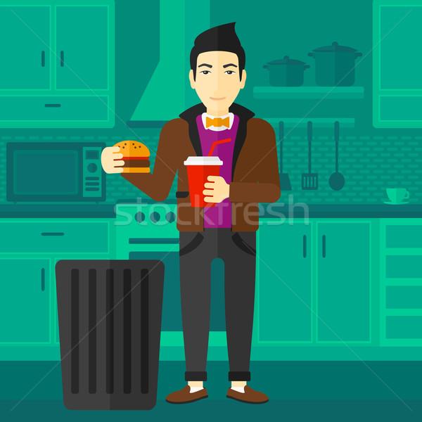 Człowiek asian stałego kuchnia Zdjęcia stock © RAStudio