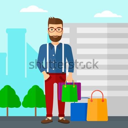 Buyer with shopping bags. Stock photo © RAStudio
