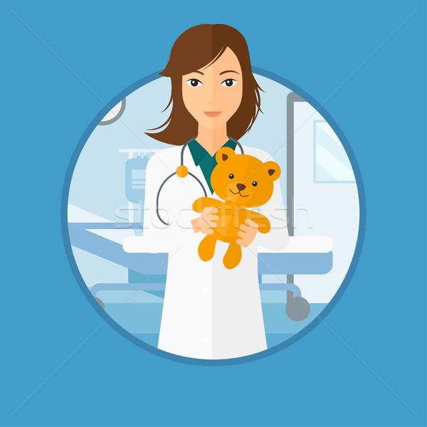 çocuk doktoru doktor oyuncak ayı genç kadın Stok fotoğraf © RAStudio