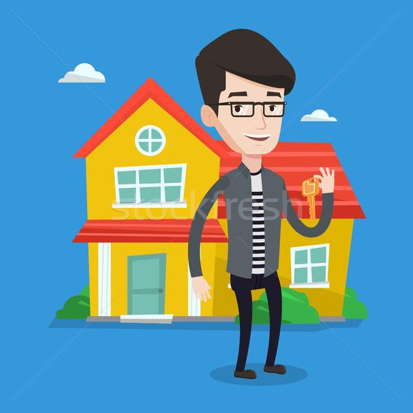 Immobilienmakler Schlüssel jungen männlich halten lächelnd Stock foto © RAStudio