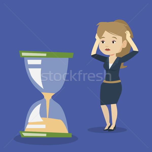 Zdesperowany business woman patrząc klepsydry ostateczny termin Zdjęcia stock © RAStudio